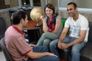 3 international students sitting in the ISSO office