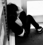 Depression: Girl scrunched in corner