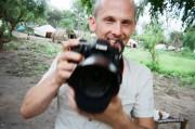 Marc Ellison holding a camera