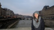 Jessica standing by the Seine River
