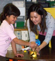 Instructor showing child a science project