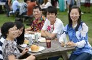 Grad Students at a picnic table at Orientation BBQ