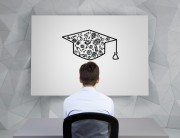Man facing board with a mortar board drawn on it