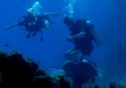 Scuba divers in deep ocean