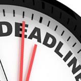 "clock face that says ""deadline"""