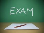 """the word """"exam"""" written on a blackboard"""