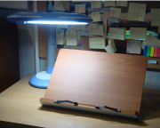 study lamp in front of bookstand