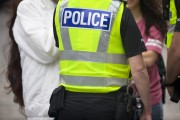 """Policeman's jacket with word """"police"""" emblazoned across it"""