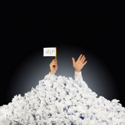 Person buried under a mountain of paperwork