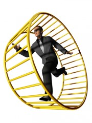 man running around in a large wheel