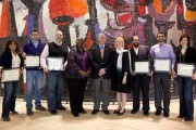 Six grad students holding their TA Excellence Awards