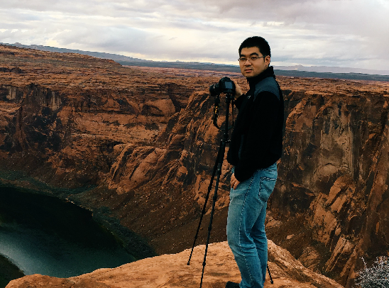C. Liang standing on top of a mountain