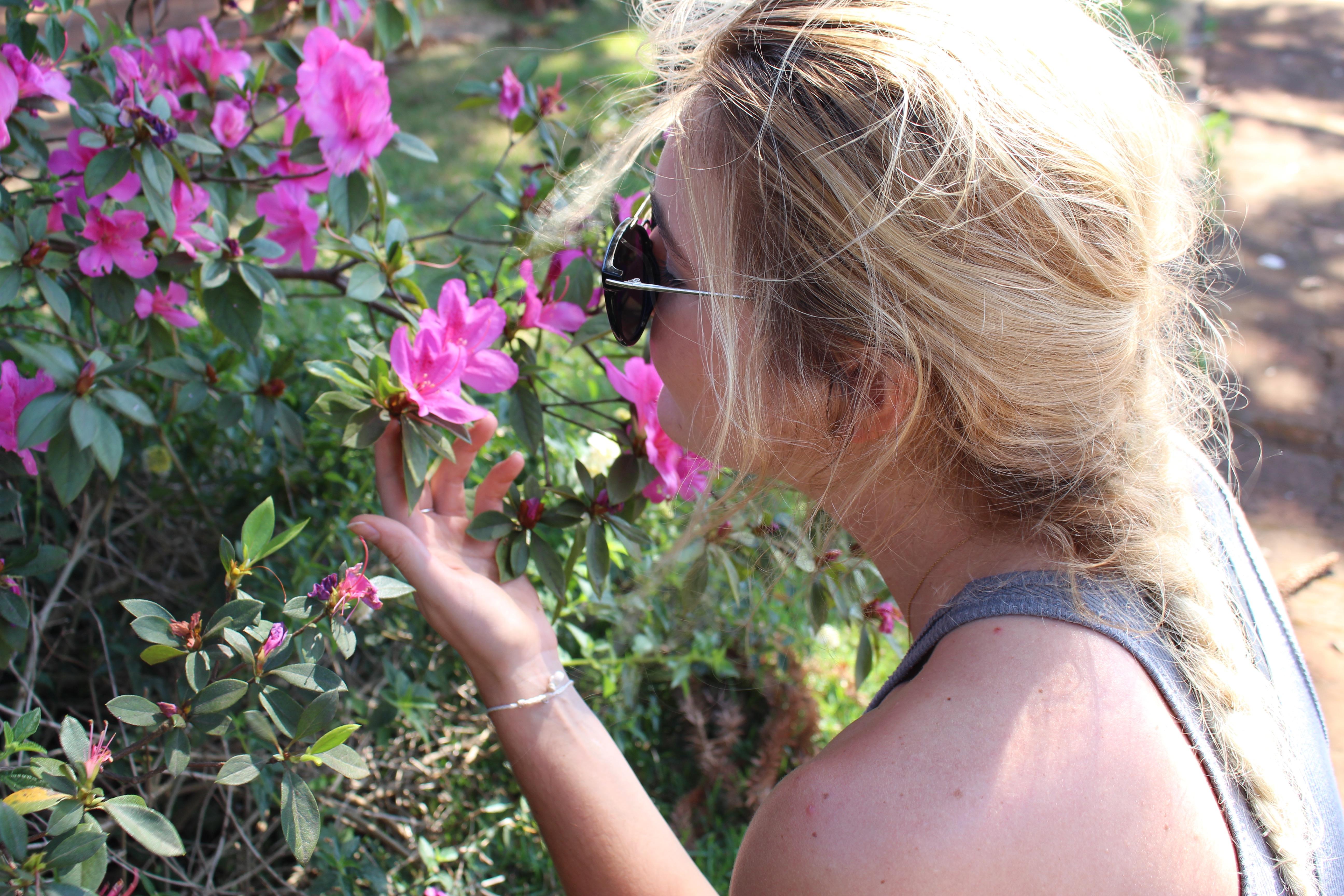 Renay Cormier in Brazil smelling flowers