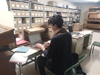 Kate Jordan working in the archives