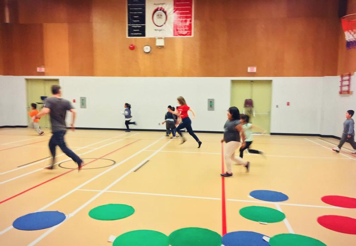 Kids playing tag at Barton school