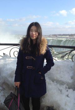 Yili-Zhou wearing winter coat
